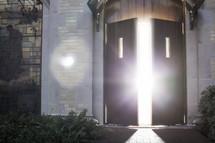 glow of sunlight and sunburst through an open door at church