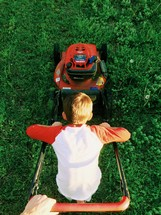 father and son cutting the grass
