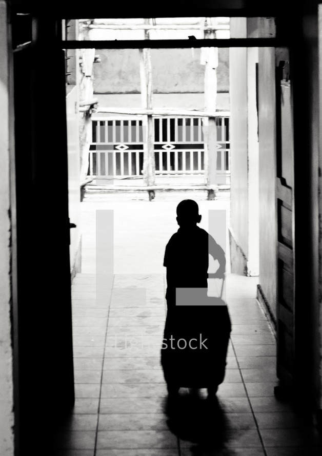 silhouette of a boy child with a suitcase