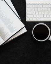 keyboard, Bible, journal, coffee mug on a desk