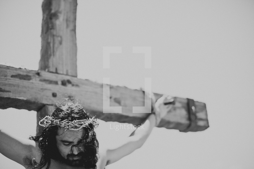 Jesus hanging from the cross with the crown of thorns placed upon his head.