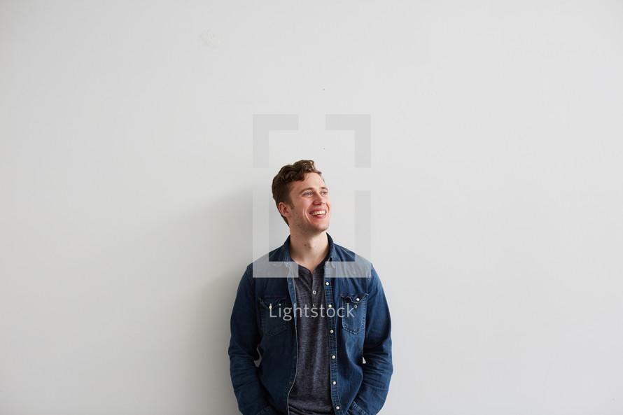 portrait of a man smiling in studio