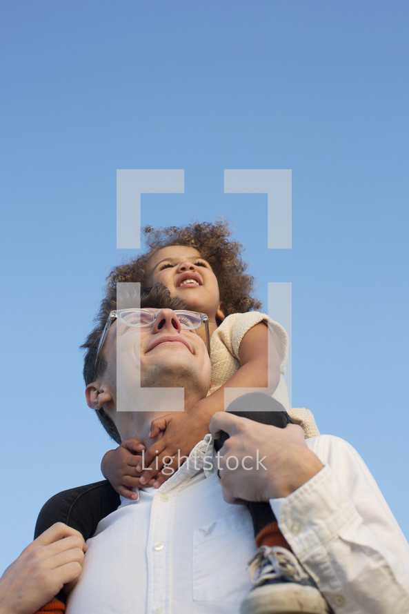 riding on father's shoulders