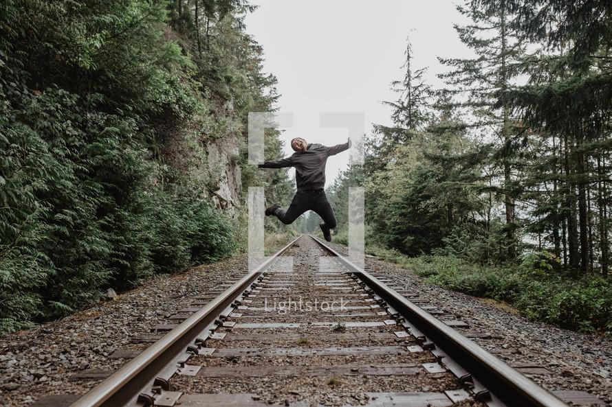 jumping high above train tracks