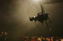 a video camera over an audience