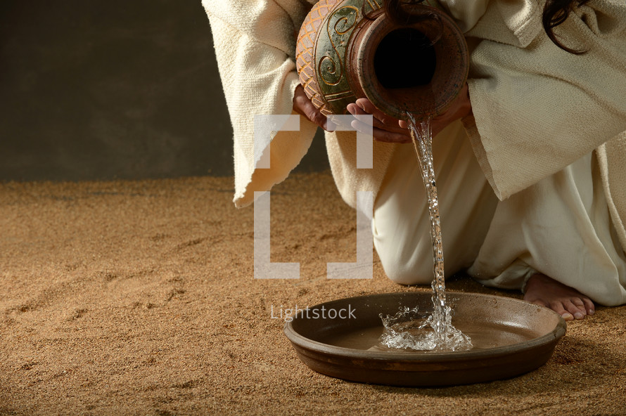 Jesus pouring water