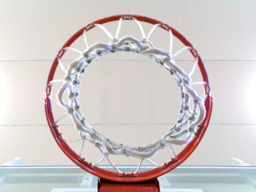 The basketball hoop seen from directly underneath.