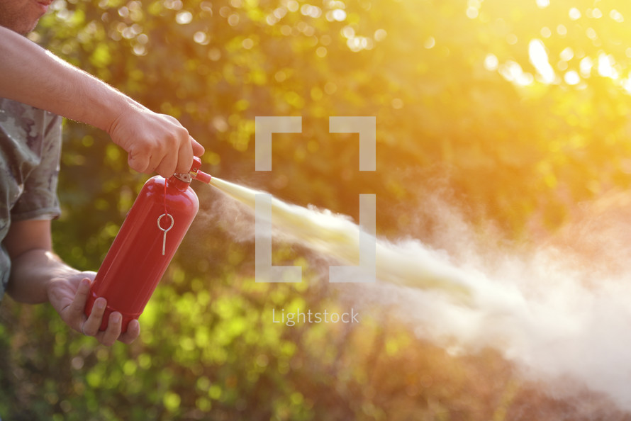 man demonstrating how to use a fire extinguisher