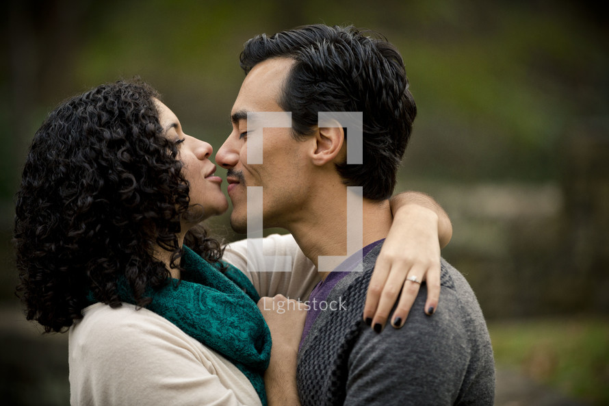 woman kissing the nose of a man