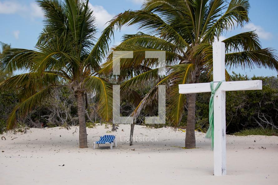 white cross on a beach