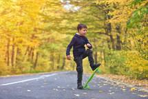 boy riding skateboard outdoors in autumn environment on sunset warm light