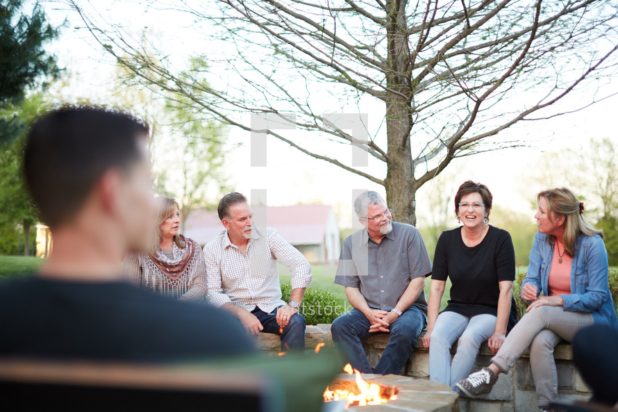 friends sitting around a fire pit
