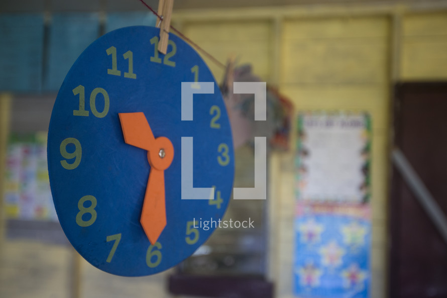 clock cut out in a classroom