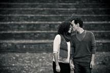 man kissing a woman's nose
