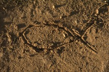 Jesus fish drawn in the sand