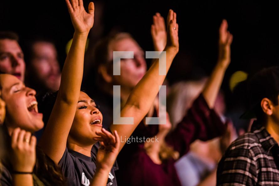 people singing in praise