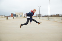 teen boy jumping up