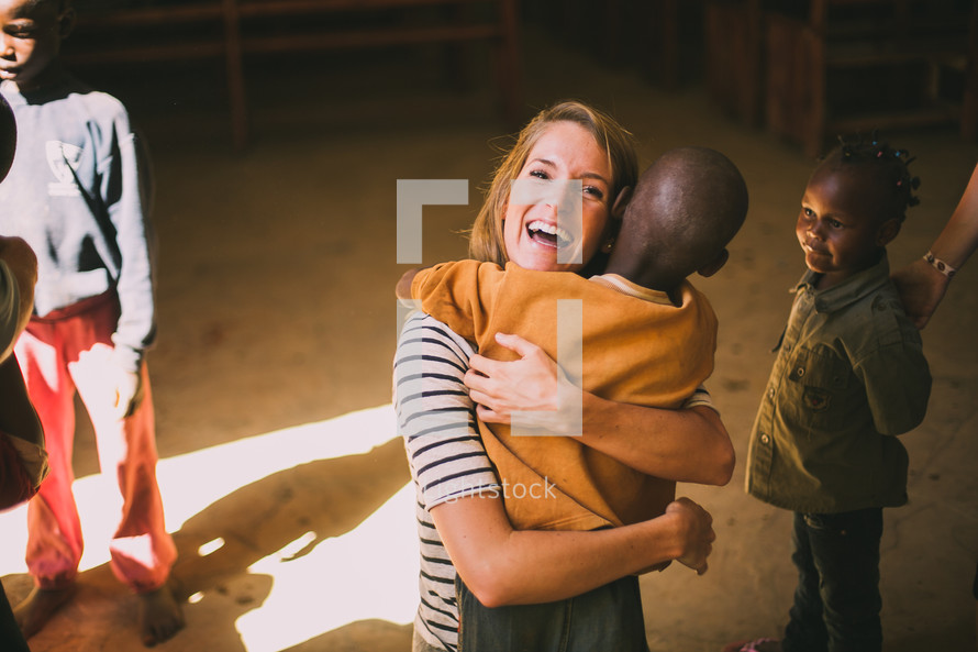 missionary woman hugging a child