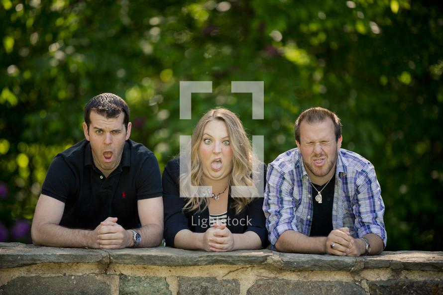 adult siblings making faces