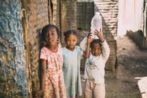 young girls holding a bottle of water