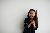 a girl praying in studio