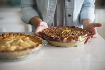 a woman baking pies in the kitchen