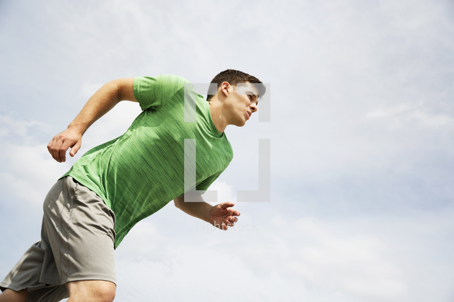 a man running and exercising.