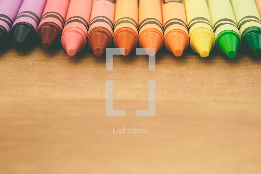 rainbow border of crayons