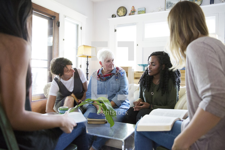 woman's group Bible study having discussions in a living room.