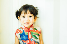 smiling little girl in a traditional Chinese dress