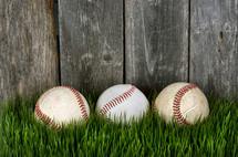 baseballs in grass