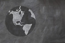 Drawing of planet earth on chalkboard.