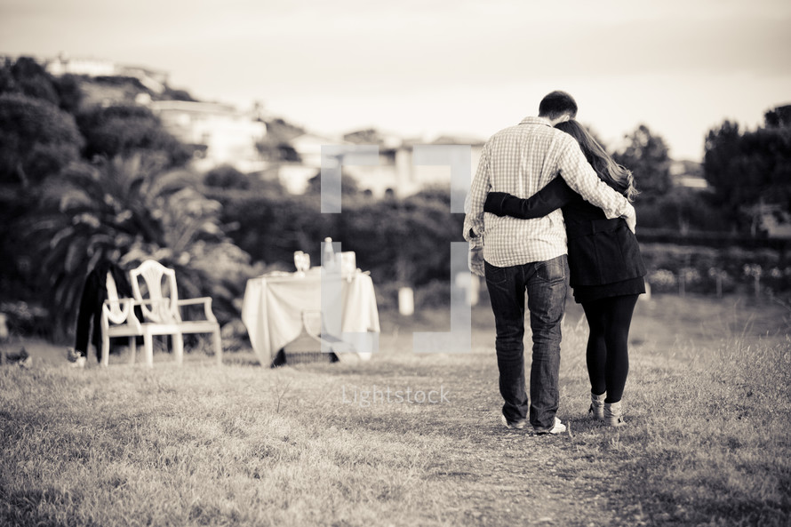 man and woman embracing - walking outdoors - dinner