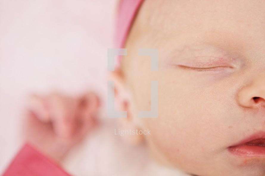 Closeup of infant girl sleeping