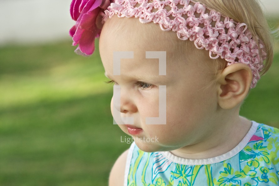 profile of toddler girl in a head band