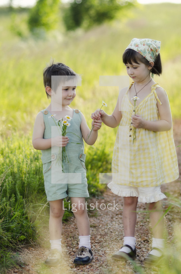 Brother and sister picking flowers