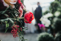 distant groom and wedding flowers