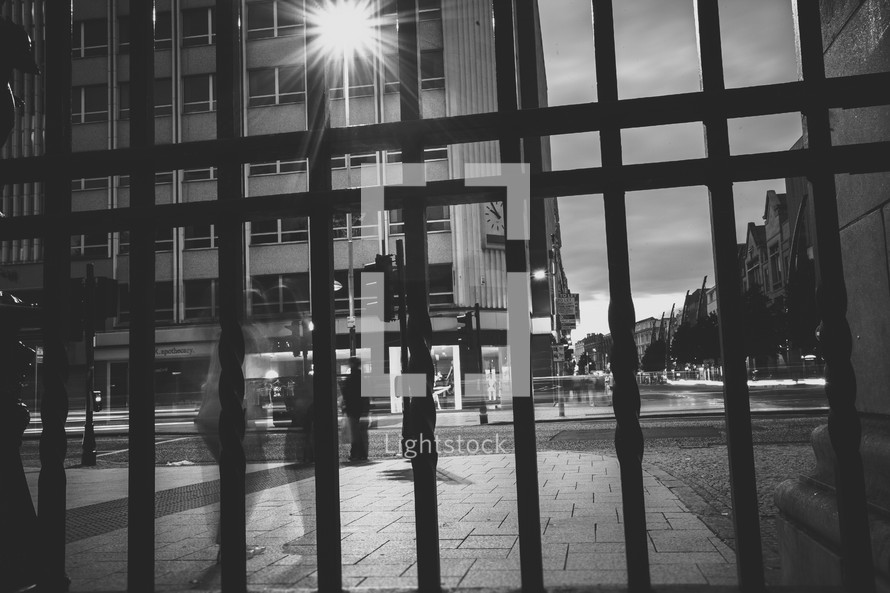 building through the bars of a gate