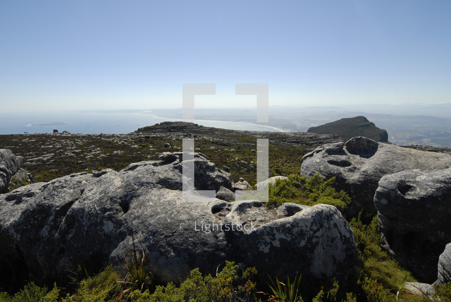 Rocks on the top of a coastal mountain top (Robben Island in the background)