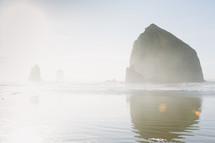 rock peaks in the ocean and mist