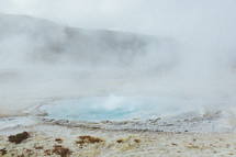 steam over a hot spring
