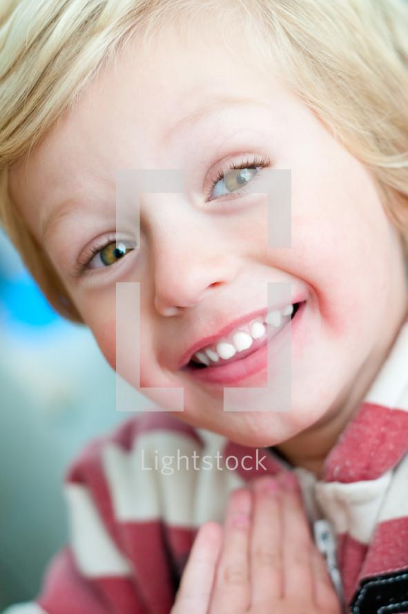 A happy boy smiling