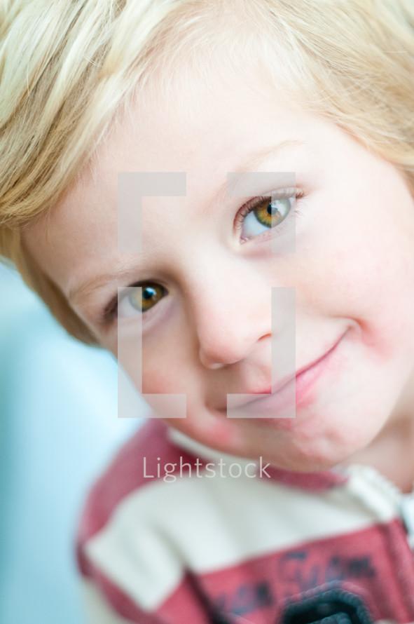 little blonde boy smiling