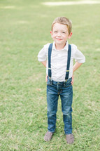 a happy boy child in suspenders