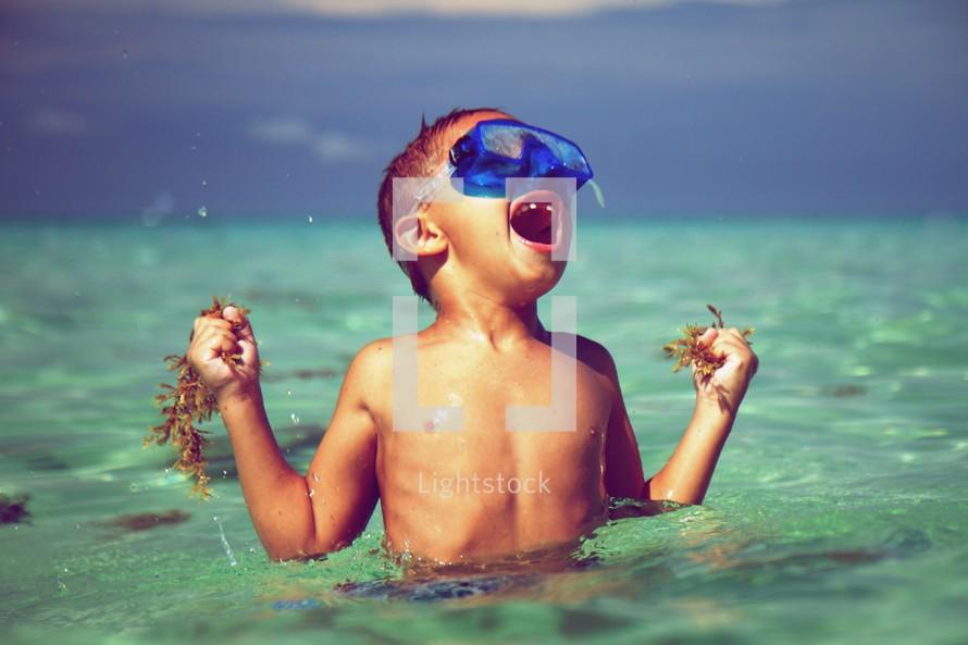 Little boy snorkeling in the ocean