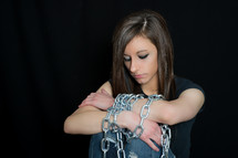 A woman chained.