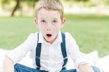 a little boy making a silly face