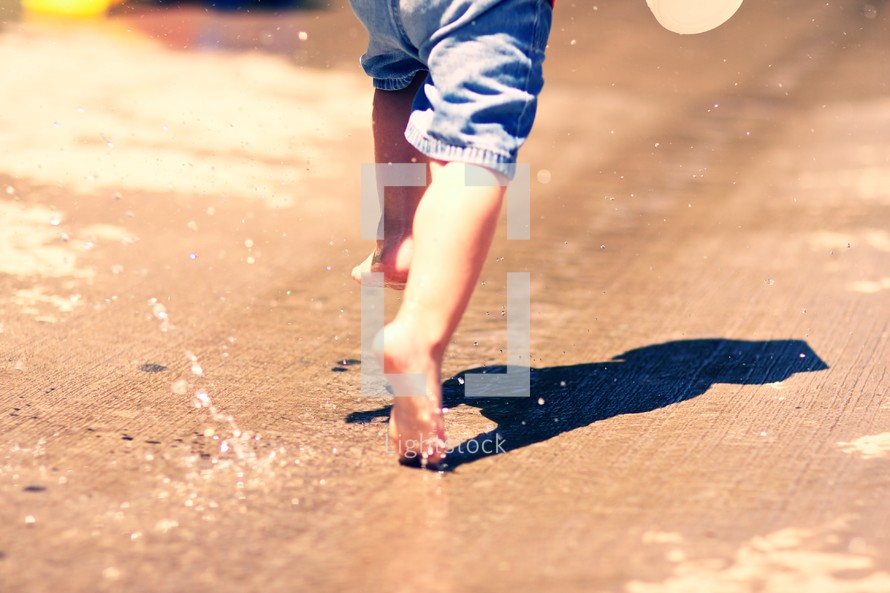 A child running through a puddle