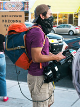 cameraman for a news station covering the protests