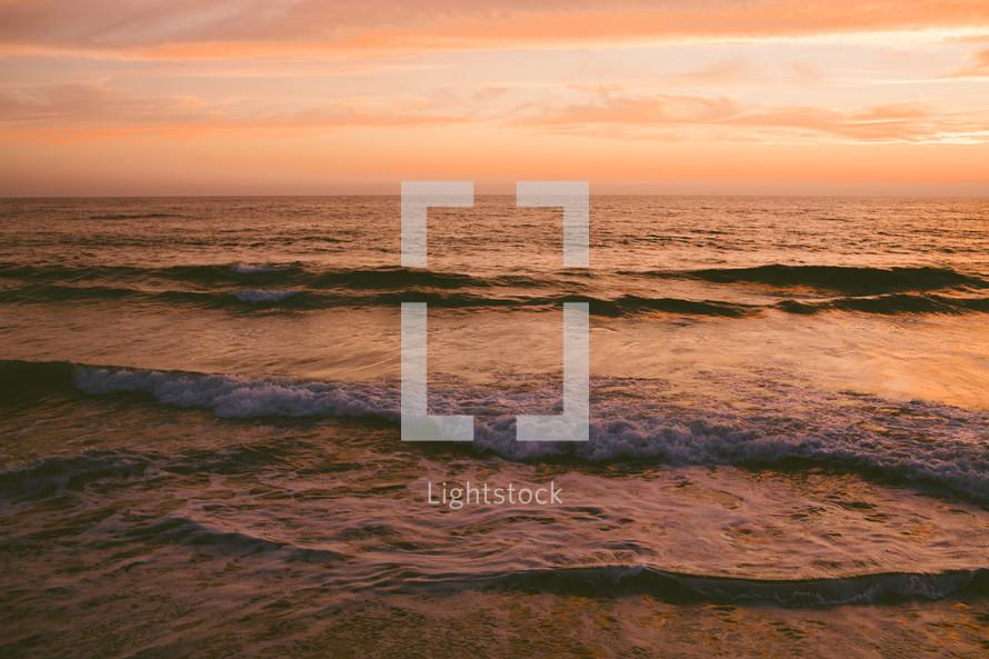 Beach waves at sunset